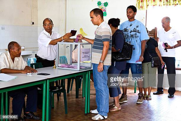 A man casts his ballot in the polling station of Cayenne on the French South American territory of Guiana on January 10 for the referendum on the...