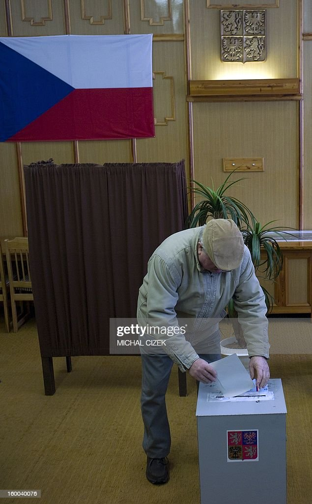 A man casts his ballot in the second round of the first direct Czech casts his ballot during the second round of the first direct Czech presidential election on January 25, 2013 in Sykorice village, 50km from Prague. Czechs went to the polls to choose a new president between a former communist and a 75-year-old aristocrat whose Sex Pistols-inspired campaign brought the election to life and down to the wire.