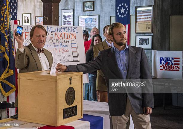 A man casts his ballot inside a polling station just after midnight on November 6 2012 in Dixville Notch New hampshire the very first voting to take...