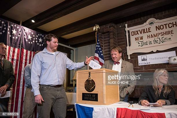 TOPSHOT A man casts his ballot inside a polling station just after midnight on November 8 2016 in Dixville Notch New Hampshire the first voting to...