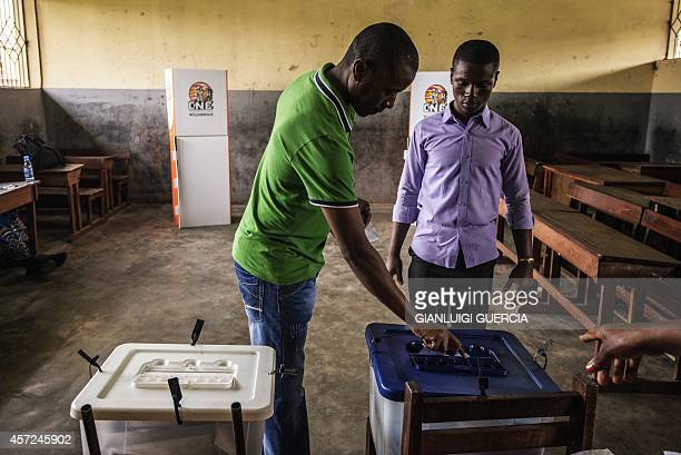 A man casts his ballot on October 15 2014 during general elections at a voting station in Maputo Mozambicans started voting on October 15 in a tough...