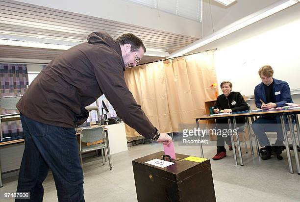 A man casts his ballot paper in the Icelandic national referendum at a polling station in Reykjavik Iceland on Saturday March 6 2010 Icelanders are...