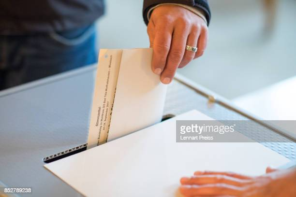 A man casts his election ballots at a polling station during German federal elections on September 24 2017 in Bayrischzell Germany German Chancellor...