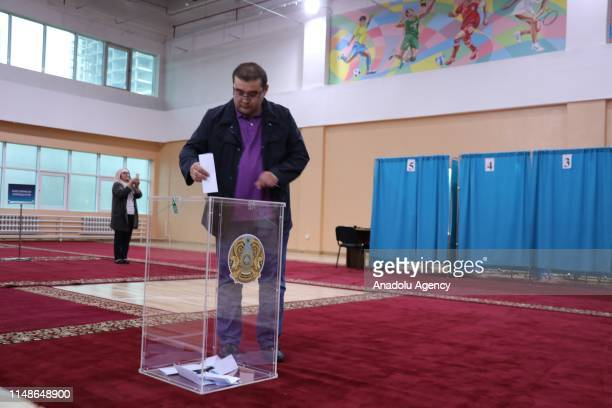 A man casts his vote at a polling station during presidential elections in Nur Sultan Kazakhstan on June 09 2019