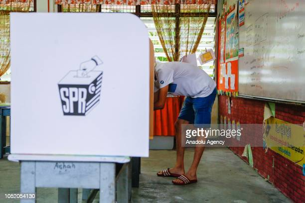 A man casts his vote at a polling station during the byelection in Port Dickson on October 13 2018 The Port Dickson seat was vacated to enable Anwar...