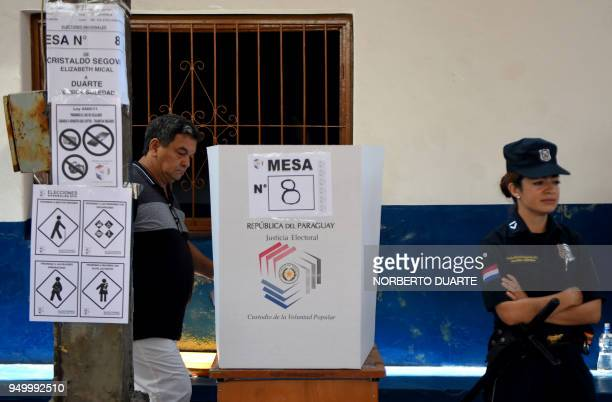 A man casts his vote at a polling station in Asuncion on April 22 during Paraguay's presidential election Opinion polls give Mario Abdo Benitez of...