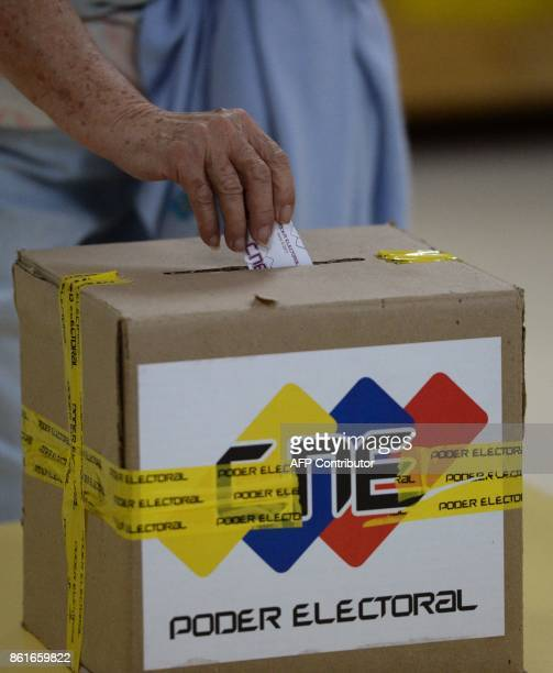 A man casts his vote at a polling station in Caracas' municipality of Baruta where people choose the governor for the state of Miranda during...