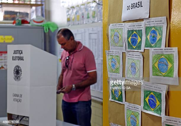Man casts his vote at a polling station inside a public school in Brasilia, Brazil on October 05, 2014. More than 142 million Brazilians went to the...