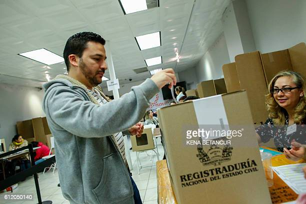 A man casts his vote at a polling station inside the Colombia Consulate in New York on October 2 2016 Colombians are voting for the referendum on...
