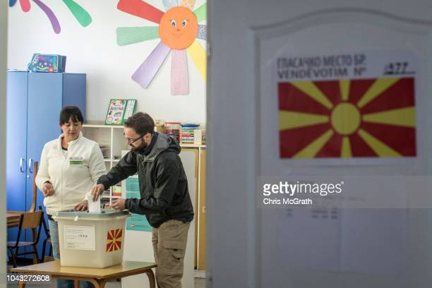 A man casts his vote at a polling station on September 30 2018 in Tetovo Macedonia Macedonians all across the country went to the polls today to vote...