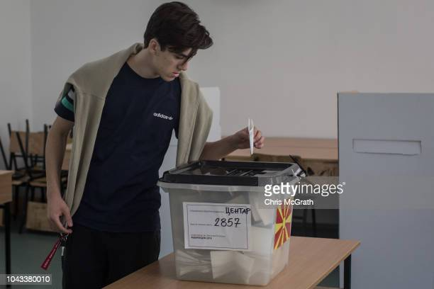 A man casts his vote at a polling station on September 30 2018 in Skopje Macedonia Macedonians all across the country went to the polls today to vote...