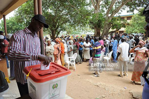 A man casts his vote at the Epe district of Lagos on April 11 2015 Nigerians return to poll nationwide to elect state governors and paliamentarians...