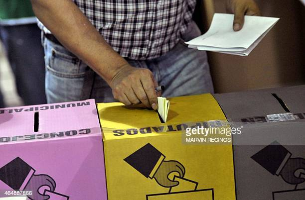 A man casts his vote during legislative and municipal elections on March 1 2015 in San Salvador El Salvador voted Sunday in tightly contested...