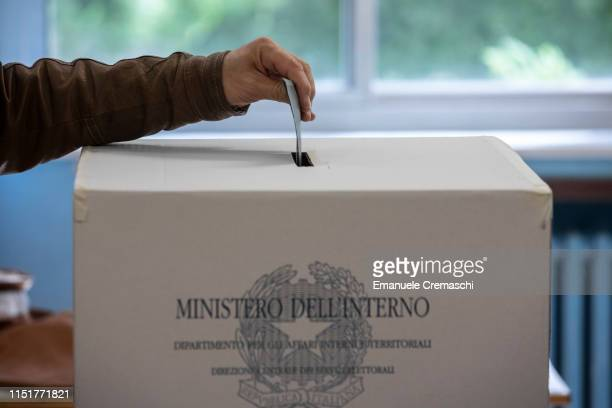Man casts his vote during the European Parliamentary election at a polling station on May 26, 2019 in Milan, Italy. More than 430 million people all...