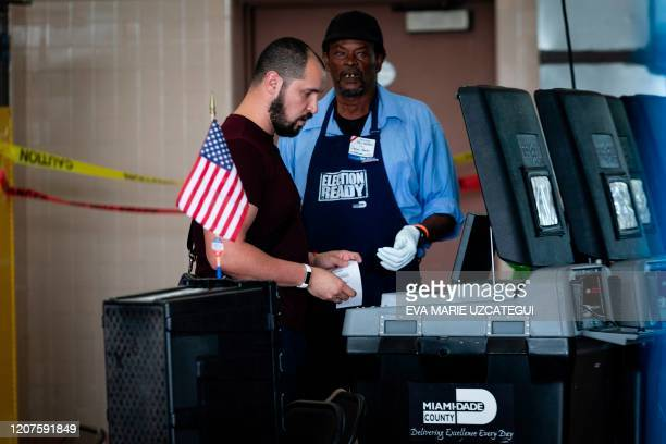 Man casts his vote during the Florida primary election in Miami, Florida, on March 17, 2020. - Millions of anxious Americans troop to polling...