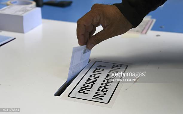 A man casts his vote during the presidential runoff in Mixco near Guatemala City on October 25 2015 Guatemalans began casting ballots in a...