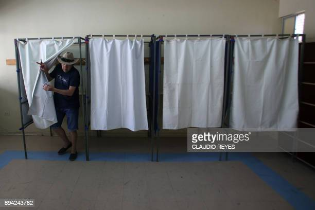 A man casts his vote during the runoff presidential election at the high school in Antofagasta on December 17 2017 Chileans started to vote in a...