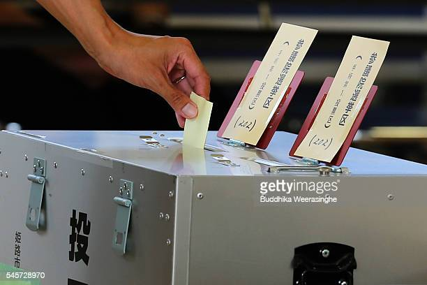 Man casts his vote for parliament's upper house election at a polling station on July 10, 2016 in Himeji, Japan. Japan went to vote Sunday to select...