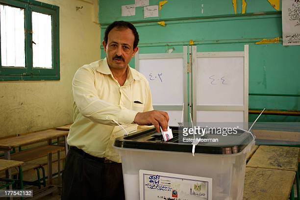 Man casts his vote in the first round of the presidential elections in Cairo, Egypt on May 23rd, 2012.