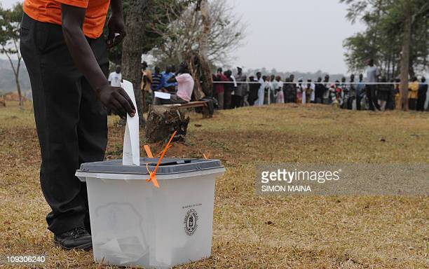 A man casts his vote on February 18 2011 in the western Ugandan town of Kiruhura 280 kms southwest of the capital Kampala Some 14 million voters...