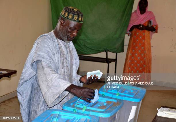 A man casts his vote on September 1 2018 at the polling station in Nouakchott for the country's legislative regional and local elections Mauritania a...