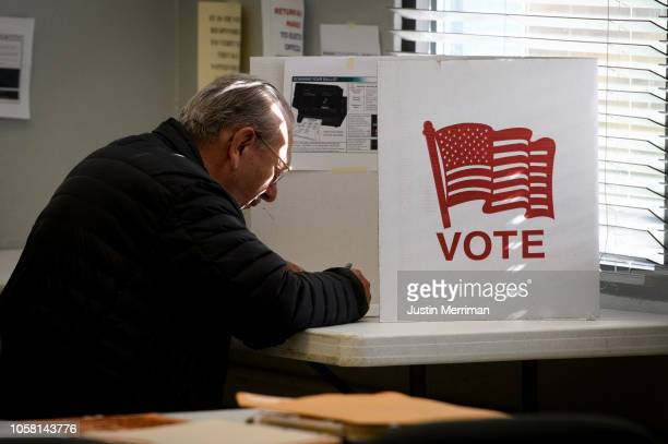 A man casts his votes at the City Park Armory polling location on Election Day on November 6 2018 in Cambridge Ohio Turnout is expected to be high...