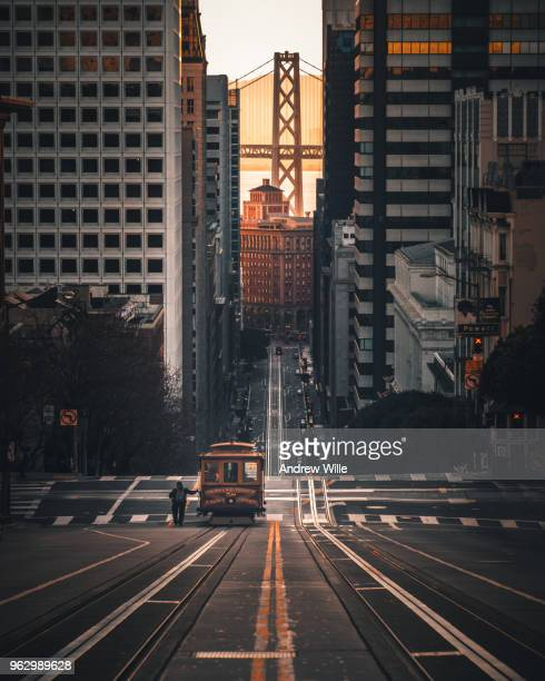 man catches cable car - san francisco california stock photos and pictures