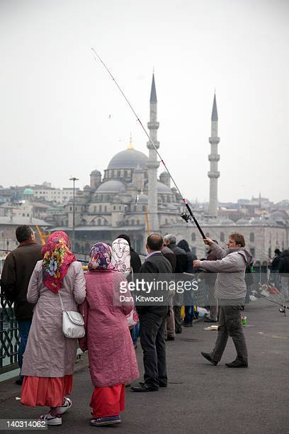 A man catches fish on the Galata Bridge on February 24 2012 in Istanbul Turkey Though not the capital Istanbul is the cultural economic and financial...
