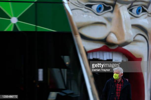 A man catching a tram in St Kilda wears a face mask on July 11 2020 in Melbourne Australia Victorian Premier Daniel Andrews suggested in yesterday's...
