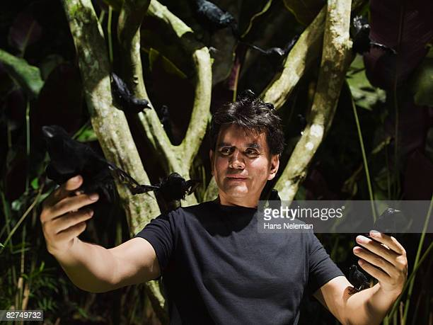 man catching crows in the forest - las posas stock pictures, royalty-free photos & images