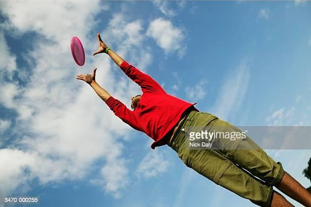 Man Catching Frisbee