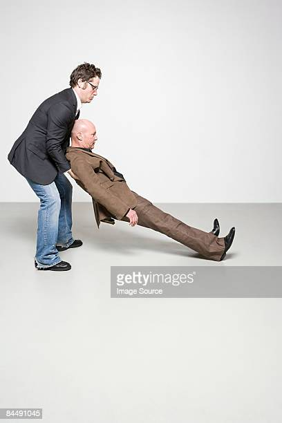 man catching man - fainting stock pictures, royalty-free photos & images