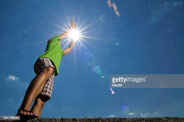 Man catching stone in sun