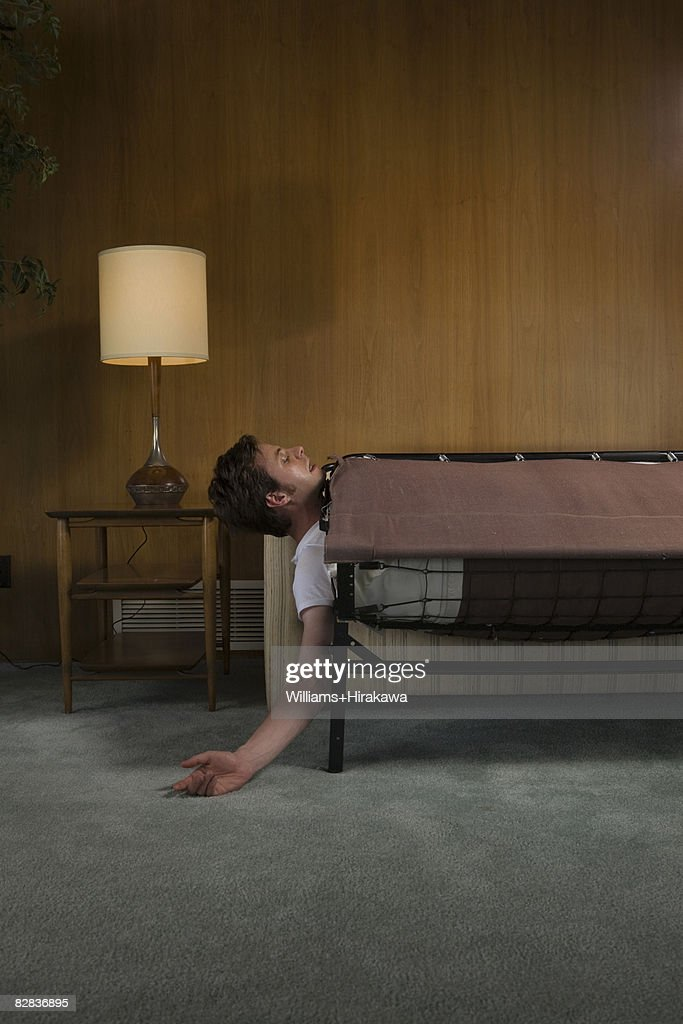 Man caught in collapsed sofabed : Stock Photo