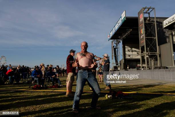 A man celebrates after the Richmond Tigers win in the AFL grand final at the 2017 Deni Ute Muster on September 30 2017 in Deniliquin Australia The...