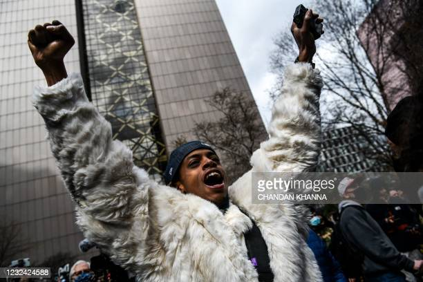 Man celebrates as the verdict is announced in the trial of former police officer Derek Chauvin outside the Hennepin County Government Center in...