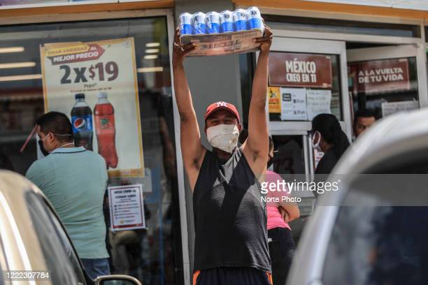 A man celebrates lifting the 24 cans of beer he bought on May 1 2020 in Hermosillo Mexico A few stores in Hermosillo and the Northern State of Sonora...