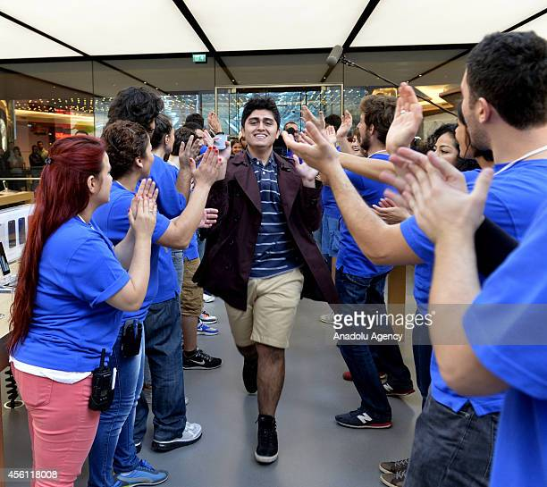 A man celebrates to buy as iPhone 6 and iPhone 6 Plus retail sales begin at Apple Store Zorlu Center in Istanbul Turkey on September 26 2014