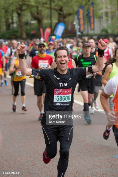 A man celebrates with just 600 meters to go of The Virgin London Marathon at Birdcage Walk on 28th April 2019 in London in the United Kingdom Now in...