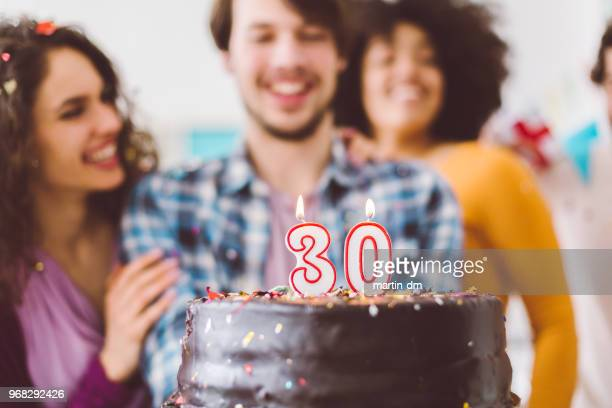 Man celebrating 30th birthday with friends