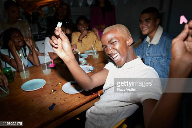 man celebrating birthday with friends at home - generation z stock pictures, royalty-free photos & images