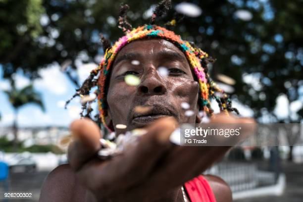 man celebrating life with confetti - jamaica stock pictures, royalty-free photos & images