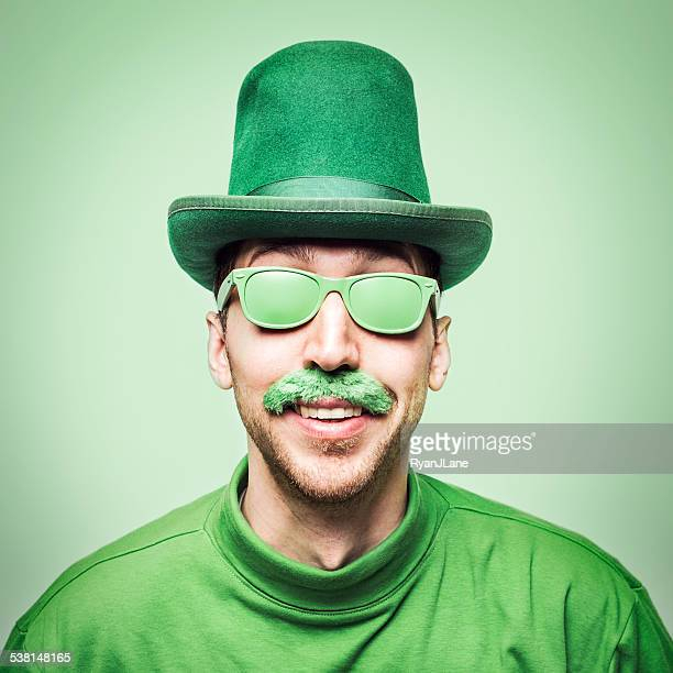 man celebrating saint patricks day - st patricks day stock pictures, royalty-free photos & images
