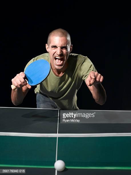 Man celebrating table tennis victory