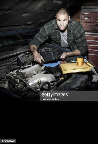 Man changing car filters
