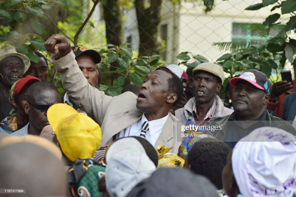 A man chants slogans while making a gesture after hearing of... : News Photo