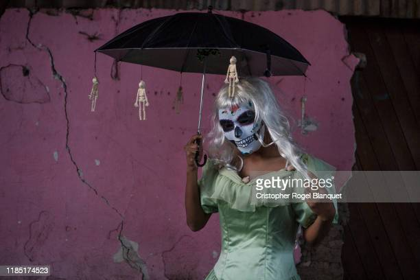 A man characterized by Catrina poses as part of the 'Day of the Dead' celebrations on November 2 2019 in Oaxaca Mexico Every year people in Mexico...
