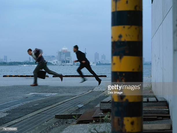 Man chasing another at jetty