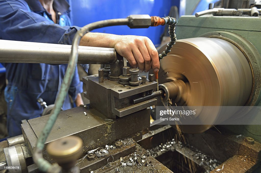 A man checking a milling cutter : Stock Photo