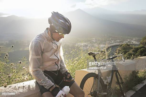 Man checking his phone during cycling training